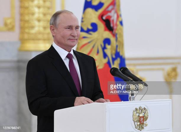 Russian President Vladimir Putin delivers a speech during a ceremony to receive credentials from foreign ambassadors at the Moscow Kremlin's...