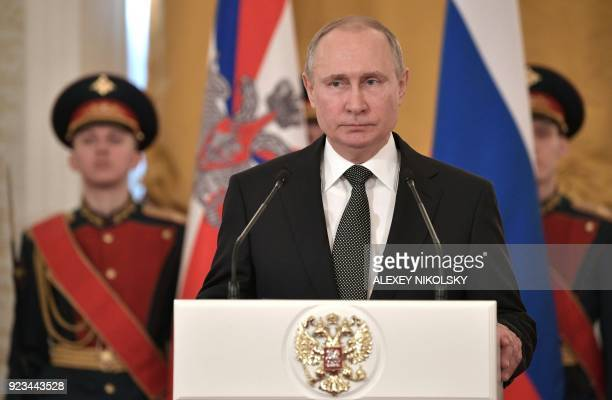 Russian President Vladimir Putin delivers a speech during a ceremony to present national award and to mark the Defender of the Fatherland Day at the...