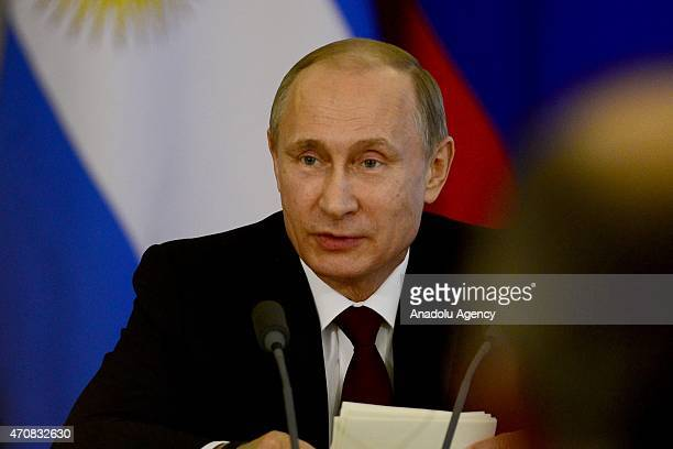 Russian President Vladimir Putin delivers a speech during a joint press conference with Argentine President Cristina Fernandez de Kirchner at the...