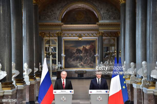 Russian President Vladimir Putin delivers a speech during a joint press conference with French President Emmanuel Macron following their meeting at...