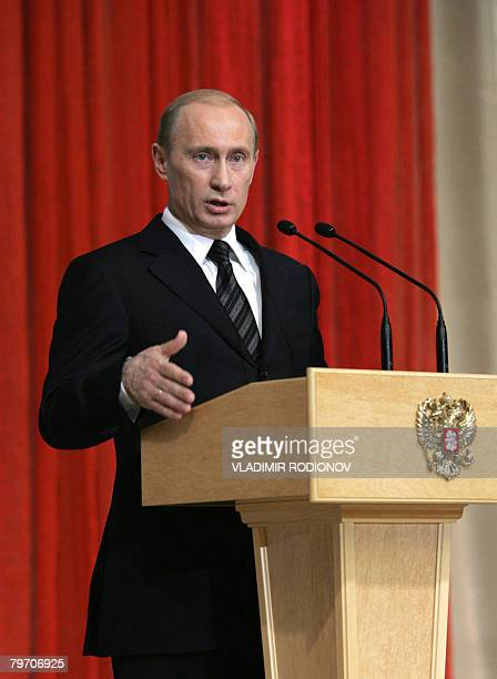Russian President Vladimir Putin delivers a speech during a meeting with veterans of gas industry at the State Kremlin Palace on the day of the...