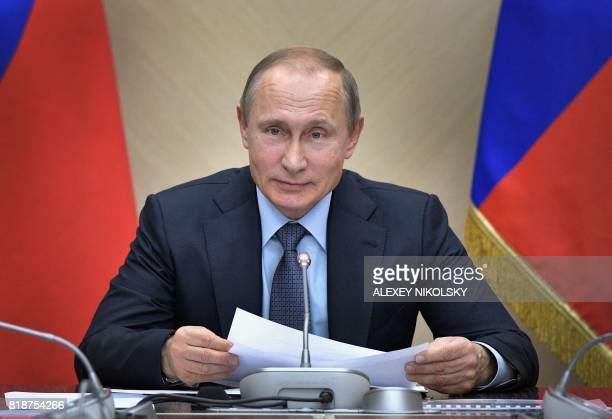 Russian President Vladimir Putin delivers a speech during a meeting with Russia's Government in his residence in NovoOgaryovo outside Moscow on July...