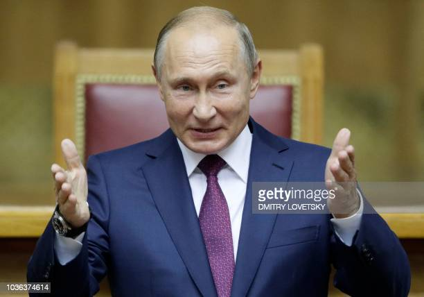 Russian President Vladimir Putin delivers a speech during a plenary session of the Second Eurasian Women's Forum in Saint Petersburg on September 20,...