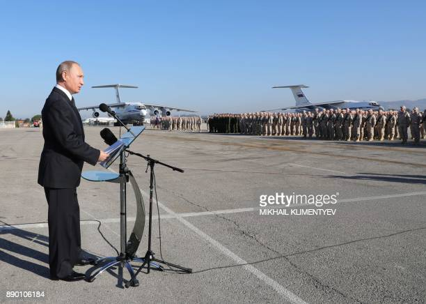 Russian President Vladimir Putin delivers a speech during his visit to the Russian air base in Hmeimim in the northwestern Syrian province of Latakia...