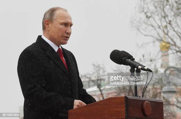 Russian President Vladimir Putin delivers a speech during the opening ceremony of the monument to Vladimir the Great in Moscow on November 4 as part...