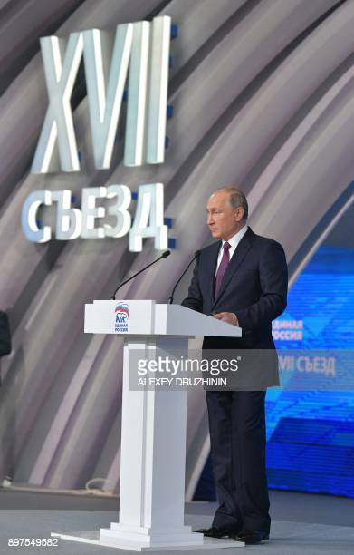 Russian President Vladimir Putin delivers a speech during the United Russia Party's 17th convention in Moscow on December 23 2017 / AFP PHOTO /...