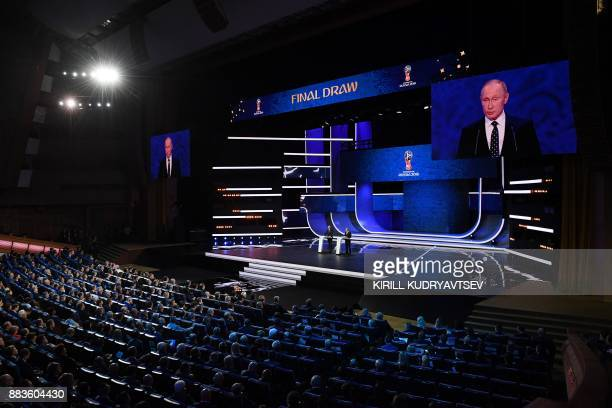 Russian President Vladimir Putin delivers a speech next to FIFA president Gianni Infantino ahead of the 2018 FIFA World Cup football tournament final...