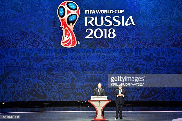 Russian President Vladimir Putin delivers a speech next to outgoing FIFA president Sepp Blatter ahead of the preliminary draw for the 2018 World Cup...