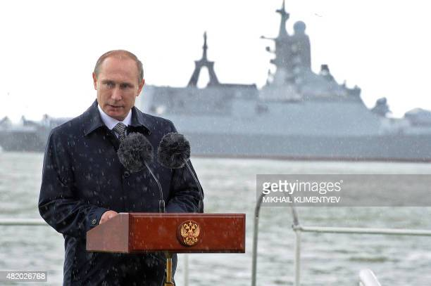 Russian President Vladimir Putin delivers a speech under the rain during celebrations for Navy Day in Baltiysk in the Kaliningrad region on July 26...