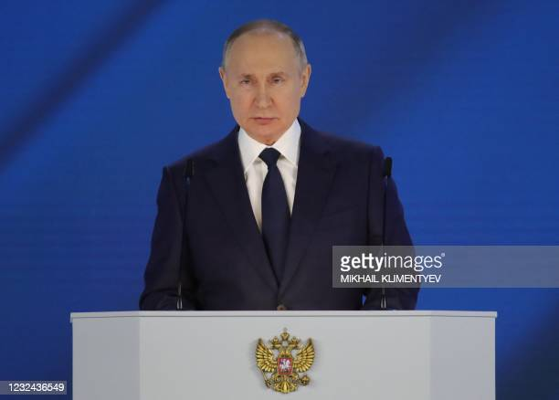 Russian President Vladimir Putin delivers his annual state of the nation address at the Federal Assembly at the Manezh Exhibition Hall in Moscow on...