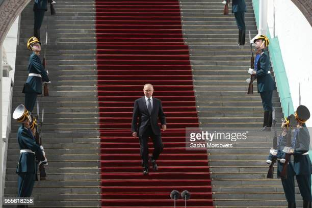 Russian President Vladimir Putin descends the stairs of the Grand Kremlin Palace during his inauguration May 7 2018 in Moscow Russia Reelected...