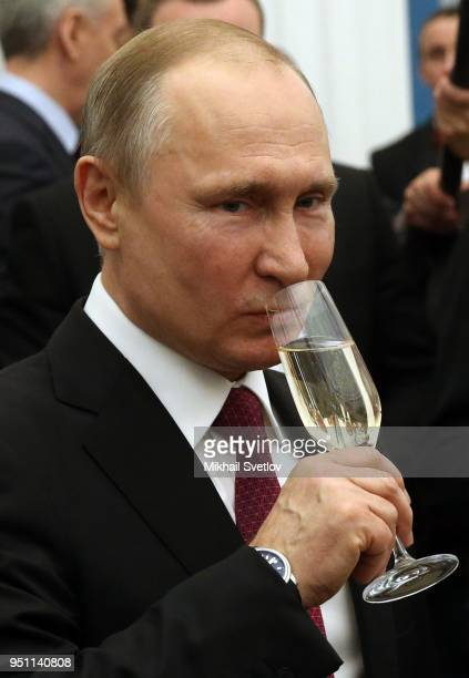 Russian President Vladimir Putin drinks champagne during an awards ceremony at the Kremlin on April 25, 2018 in Moscow, Russia. Vladimir Putin...
