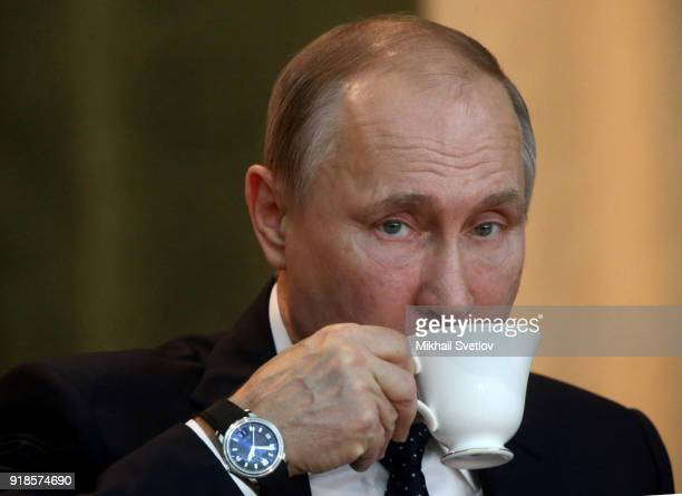 Russian President Vladimir Putin drinks tea during the meeting of the Extended Board of the Prosecutor General's Office on February 15 in Moscow...