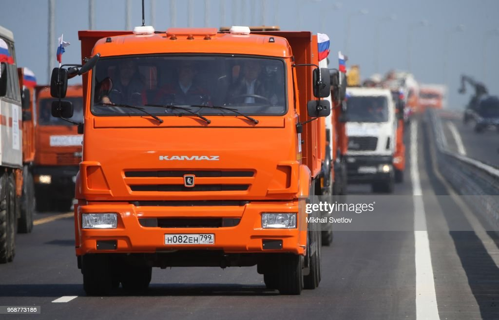 Russian President Vladimir Putin drives a KAMAZ truck at the Kerch Strait Bridge on May 15, 2018 in Kirch, Crimea. President Vladimir Putin is visiting the Crimea today, to open a newly built bridge from Taman peninsula of Krasnodar region of Russia to Crimea's Kerch peninsula. Crimea is a disputed territory annexed by Russia in 2014.