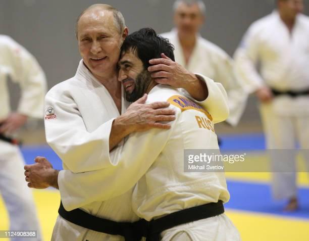 Russian President Vladimir Putin ebrasses judoka Beslan Mudranov during judo trainings at Yug Sport complex in Sochi, Russia, February 2019. Russian...