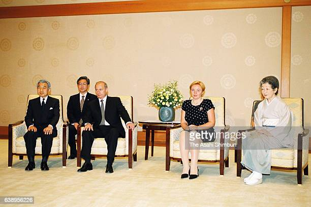 Russian President Vladimir Putin Emperor Akihito Empress Michiko and Putin's wife Lyudmila pose for photographs prior to their meeting at the...