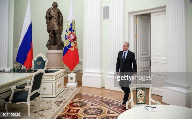 Russian President Vladimir Putin enters a hall to meet FIFA's president Gianni Infantino at the Kremlin in Moscow on February 12 2018 / AFP PHOTO /...