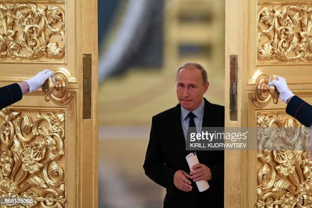 Russian President Vladimir Putin enters a hall to meet with members of the Presidential Council for Civil Society and Human Rights at the Kremlin in...