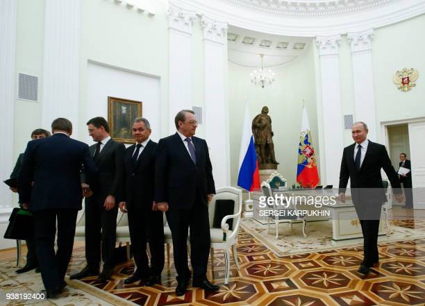 Russian President Vladimir Putin enters a hall to meet with Qatar's Emir Sheikh Tamim bin Hamad alThani at the Kremlin in Moscow on March 26 2018 /...