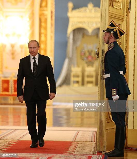 Russian President, Vladimir Putin enters the hall during a presentation ceremony of state awards marking the Day of Russia in the Grand Kremlin...