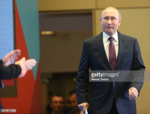 Russian President Vladimir Putin enters the hall during fhe first WHO global ministerial conference ending TB in the sustainable development era a...