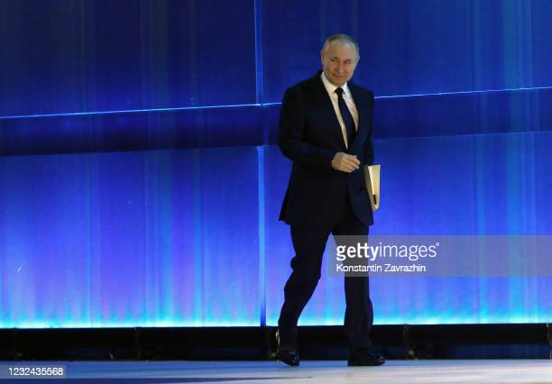 Russian President Vladimir Putin enters the hall during his annual address to the Federal Assembly on April 21, 2021 in Moscow, Russia. President...