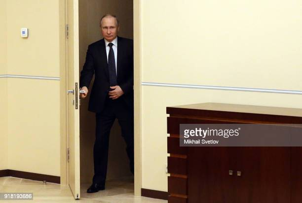 Russian President Vladimir Putin enters the hall during his meeting with participants of the Mentor Forum at NovoOgaryovo State residence on February...