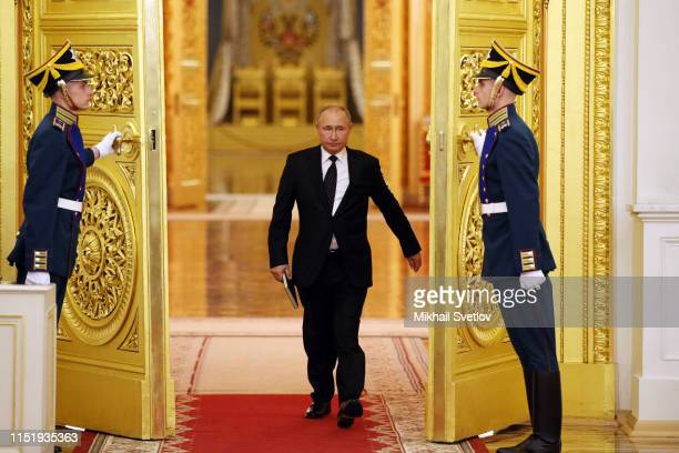 Russian President Vladimir Putin enters the hall during the meeting of State Council at the Grand Kremlin Palace, in Moscow, Russia, June 2019....