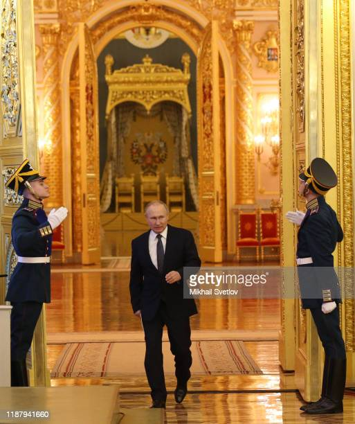 Russian President Vladimir Putin enters the hall during the reception marking the Day of Heroes of the Fatherland at Grand Kremlin Palace on December...