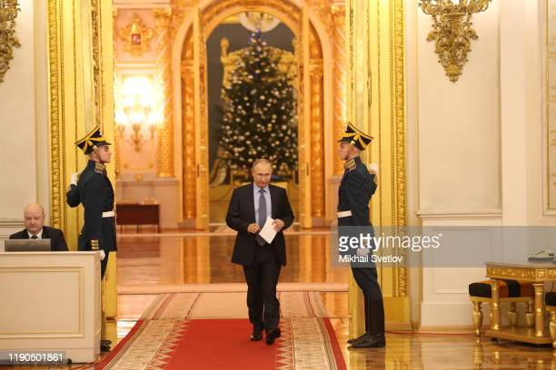 Russian President Vladimir Putin enters the hall during the State Council's meeting at Grand Kremlin Palace in Moscow, Russia, December 2019.Putin...