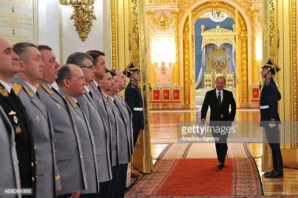 Russian President Vladimir Putin enters the hall for a meeting with senior officers and prosecutors at the Kremlin in Moscow Russia on April 09 2015