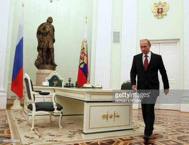 Russian President Vladimir Putin enters the hall for his talks with King Abdullah II of Jordan at the Kremlin in Moscow on October 2 2014 The talks...