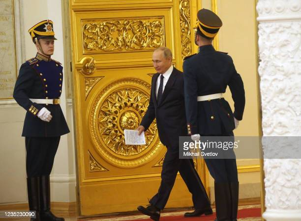 Russian President Vladimir Putin enters the hall to address Tokyo 2020 Paralympic medalists during the meeting at the Grand Kremlin Palace, on...