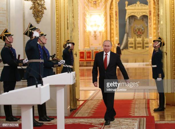 Russian President Vladimir Putin enters the hall to give a speech during the state awards ceremony at the Grand Kremlin Palace on June 12, 2017 in...