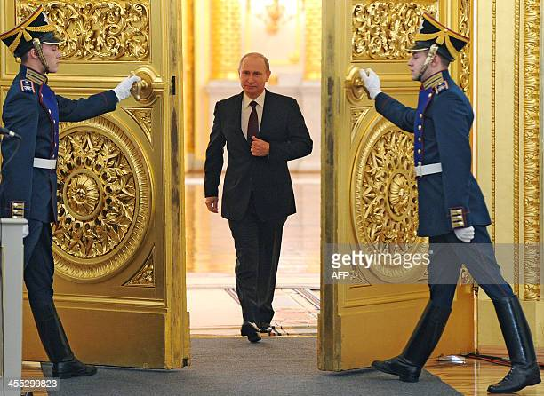 Russian President Vladimir Putin enters the St. George Hall at the Grand Kremlin Palace at the Kremlin in Moscow, on December 12 to deliver an annual...
