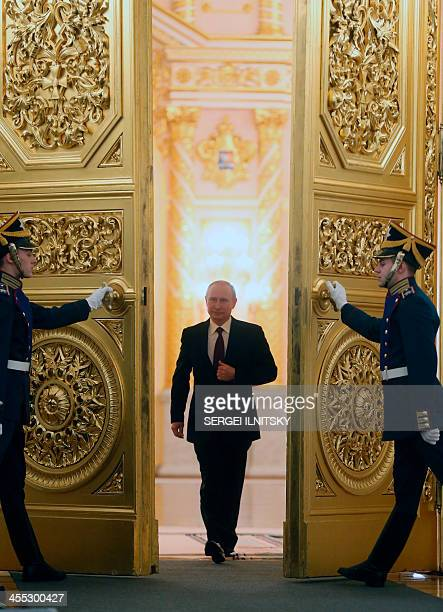 Russian President Vladimir Putin enters the St. George Hall of the Grand Kremlin Palace in Moscow, on December 12 to deliver an annual state of the...