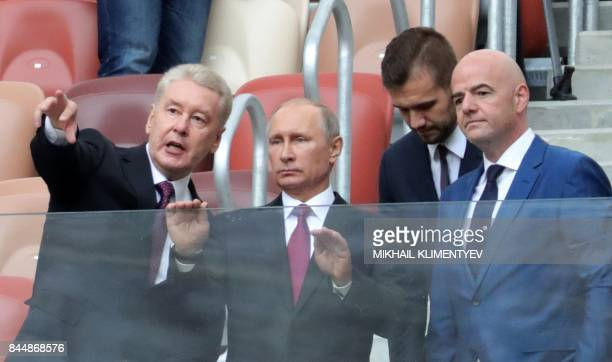 Russian President Vladimir Putin FIFA President Gianni Infantino and Moscow's Mayor Sergei Sobyanin visit the opening of the trophy tour ceremony at...