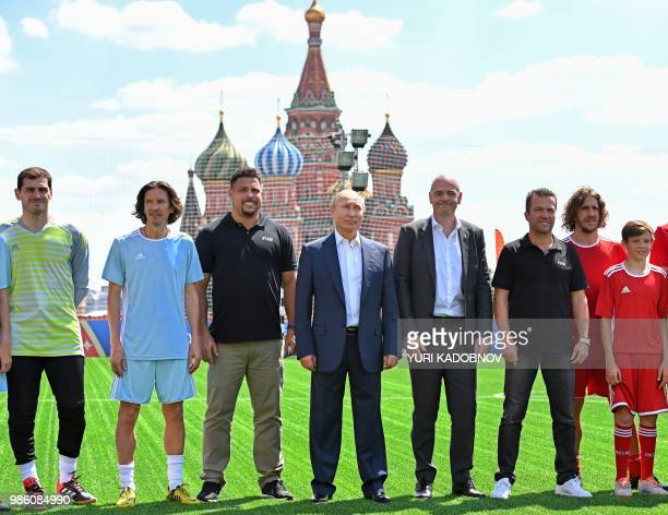 Russian President Vladimir Putin FIFA President Gianni Infantino and Russian Football Union antiracism and discrimination inspector Alexey Smertin...