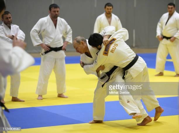 Russian President Vladimir Putin fights with judoka Beslan Mudranov during judo trainings at Yug Sport complex in Sochi, Russia, February 2019....