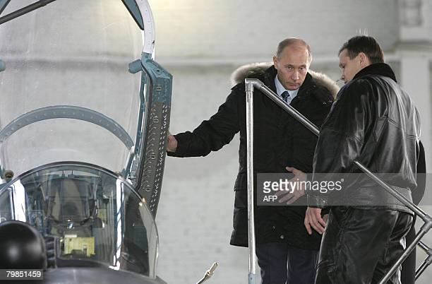 Russian President Vladimir Putin , First Deputy Prime Minister and presidential candidate Dmitry Medvedev , and an unidentified man visit the...