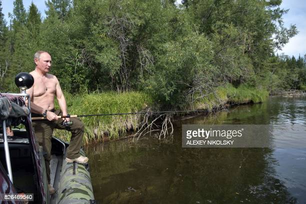 Russian President Vladimir Putin fishes in the remote Tuva region in southern Siberia The picture taken between August 1 and 3 2017 / AFP PHOTO /...