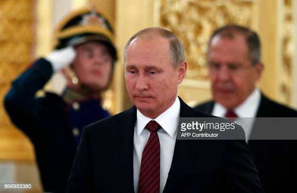 Russian President Vladimir Putin flanked by Foreign Minister Sergei Lavrov arrives for a ceremony of receiving diplomatic credentials from foreign...