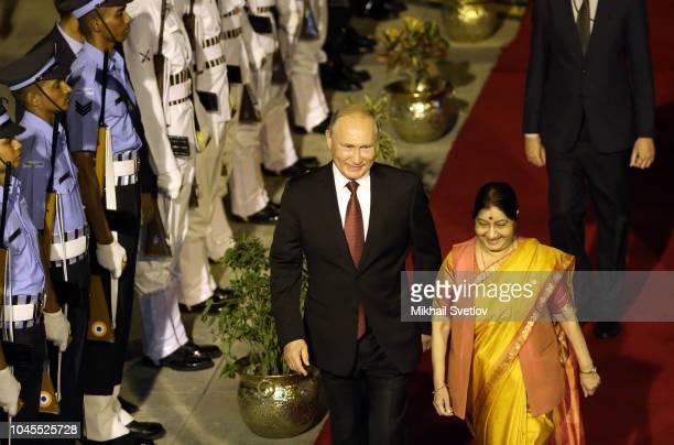 Russian President Vladimir Putin followed by India Foreign Minister Sushma Swaraj is arriving to New Delhi airport India October 2018 Vladimir Putin...