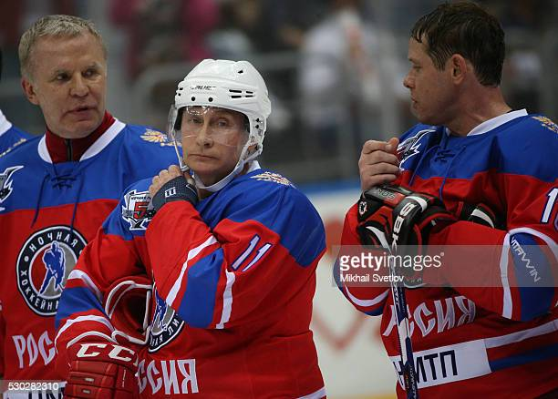 Russian President Vladimir Putin former NHL players Pavel Bure and Slava Fetisov lseen during the match of the Night Hockey League in Sochi Russia...