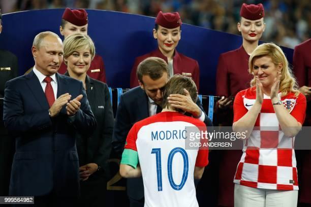 TOPSHOT Russian President Vladimir Putin French President Emmanuel Macron and Croatian President Kolinda GrabarKitarovic congratulate Croatia's...