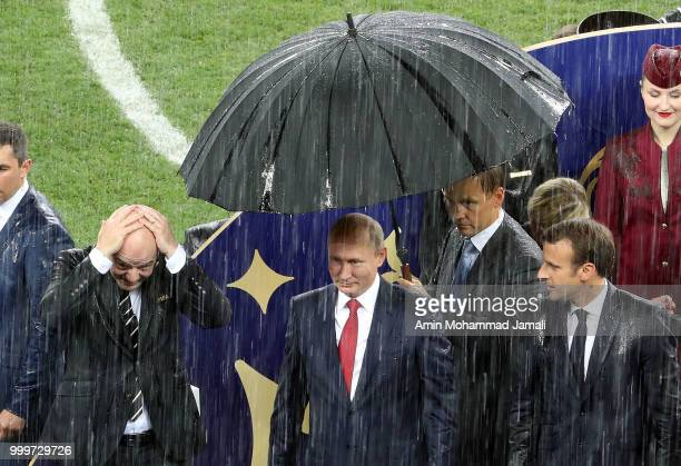 Russian President Vladimir Putin French President Emmanuel Macron and FIFA President Gianni Infantino attend the award ceremony of the 2018 FIFA...
