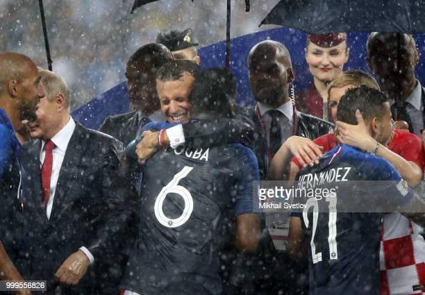 LR Russian President Vladimir Putin French President Emmanuel Macron Croatian President Kolinda GrabarKitarovic attend the 2018 FIFA World Cup final...