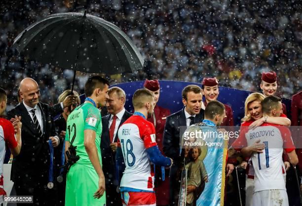 Russian President Vladimir Putin French President Emmanuel Macron Croatian President Kolinda Grabar Kitarovic and FIFA President Gianni Infantino...