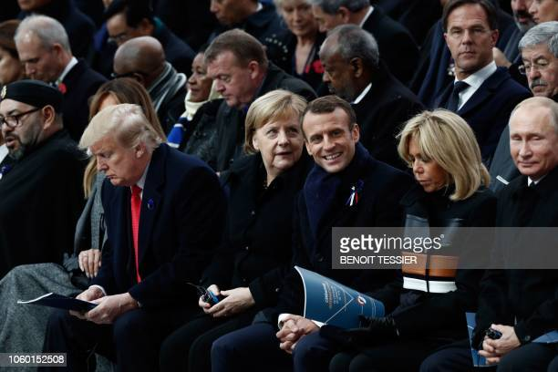 Russian President Vladimir Putin French President's wife Brigitte Macron French President Emmanuel Macron German Chancellor Angela Merkel and US...