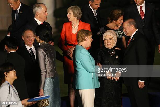 Russian President Vladimir Putin German Chancellor Angela Merkel and Turkish President Recep Tayip Erdogan seen during a family photo at the G20...